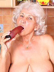 Naughty Anilos granny takes off her panties and stimulates her experienced gray haired pussy with her vibrator