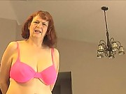 Granny Oral Angie gives a femdom handjob to young college guy and makes his cock explode