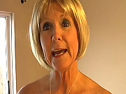Granny Honey Ray stops by to measure Johnny for a tux when she accidentally touches his cock and give him a free granny handjob