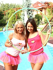 Two hot teenage girls playing with hula hoop