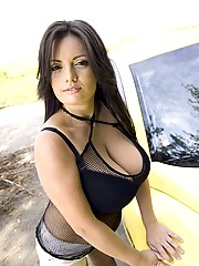 Busty babe washes her car nude