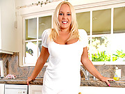 Tan blonde housewife with big tits mastubates in the kitchen sink