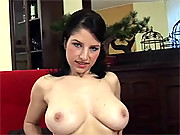 Cutie with massive knockers plays with dildo