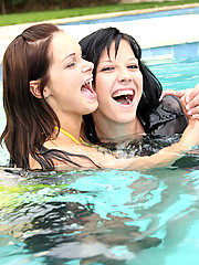 Two teenage girls frolicking in swimmingpool