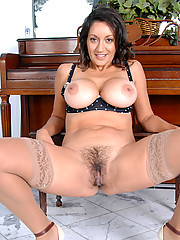 Persia Monir pops out her huge mature tits while spreading her legs for a view of her hairy pussy