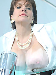 Latex gloved mature cleavage nurse