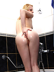 Coed chick Inessa spreads her wet pink pussy from her back to show her clitoris