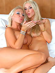 Amazing big tits lesbians fuck eachother after masterbating in these hot pics