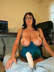 Mom Claire is shocked at the size of Billys cock and she jerks out a massive cumblast all over her face and huge 44 FF tits