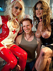 Two smoking hot latex clad evil nurses use a piece of man meat to painfully drain every ounce of man filth out of him!