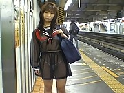 Mikan Hot Asian teen is waiting for the train in see thru dress