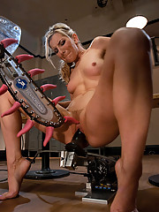 Blond working out - sweats, fucks machine, squirts on her legs, mechanical tongues lick her clit and asshole,she bobs up/down fucking black robot cock