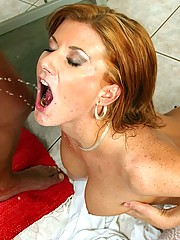 Willing redhead in sexy stockings enjoying piss and jizz