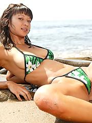 Layla looking gorgeous in her green thong bikini