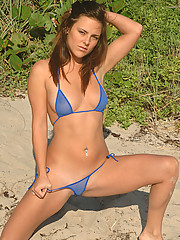Veronica plays in the sand in a sexy blue micro thong