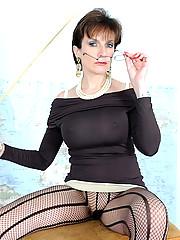 Mature dominatrix in pantyhose