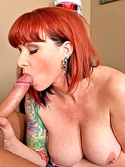 red head milf gets a ride on a massive cock