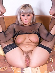 Curvy blonde Maya feels so sexy in her black mesh lingerie and cant wait to play with her pink hairy pussy. Can you wait?