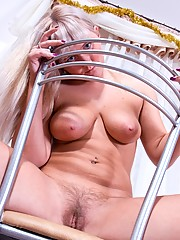 Watch as curvy blonde Maya lifts her little dress revealing her hairy moist bush and then cameltoes herself with her panties.