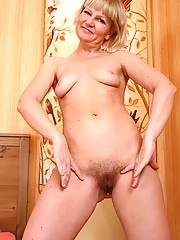 Lovely Lana comes home after a hot date and needs to get herself off. After parading around her bedroom in her sexy red lingerie she rubs her moist hairy assets.