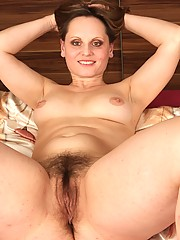 This sexy plump older women oozes elegance. Watch as she lifts her short black skirt, showing off her voluptuous curves and thick pussy hair.
