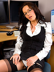 Brunette Marlyn gets sexy in her office and spreads open her pussy