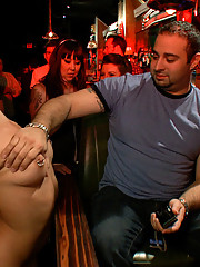 Little hottie Jynx Maze does her first porn shoot ever in a bar full of rowdy drunk strangers. She gets fucked, fondled, made to suck pussy and worshi