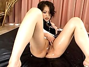 Saki Ootsuka lifts up her dress to show her shaved pussy