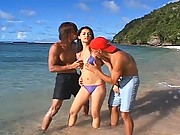 Maria Ozawa beautiful tits exposed at the beach by two horny guys