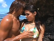 Maria Ozawa and a horny stud playing at a public beach