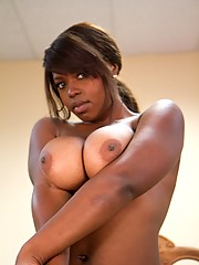 Curvy Ebony babe plays with her tits
