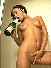 Anetta Keys pours champagne over herself in the shower