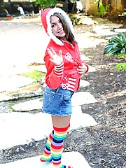 Taylor Lain has fun outside in rainbow tube socks and a short skirt