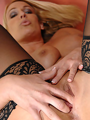 Voluptuous Anilos blonde in black stockings has a great time fingering her juice box