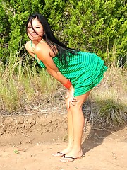 Cierra Spice becomes one with nature as she takes her green dress off in the woods