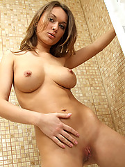 Alluring busty Aliana is a having great time in the bathroom as she wets her mouthwatering hot privates