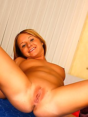 Massaging her very sensative clit with a toy