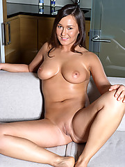 A sexy busty chick masturbating on the couch