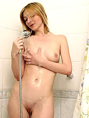 A pretty sweetie fondling herself in shower
