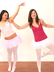 Two very sexy ballerina teenagers are dancing