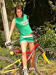 Chick on a bike pleasuring her soaked pussy