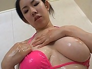 Chihiro Asou pulls down the front of her bikini to show off tits
