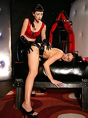 A hot caged lesbian spanked by her mistress