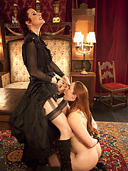 Female sex slaves cower under the heel of dominating Mistress Liliane Hunt.