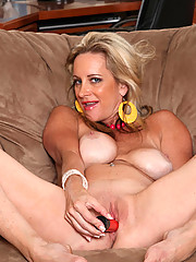 Busty blonde Cassy Torri fucks her tender cougar snatch with a big red toy