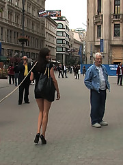 Girl is bound in the streets with her shirt over her head and her tits exposed!