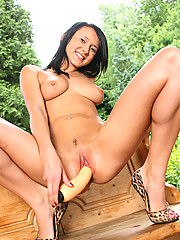 Pleasuring her soaked shaven muff with dildo