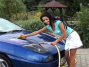 Car washing teen sweetie playing with hose