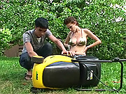 Lawnmower fixer fucks busty babe in backyard