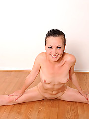 Milf Claudia Adkins feels horny while exercising so she takes off her clothes and teases her pussy